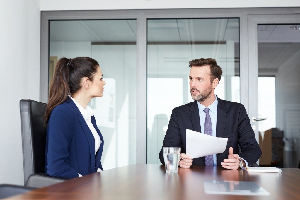 man conducting the interview for the woman applicant
