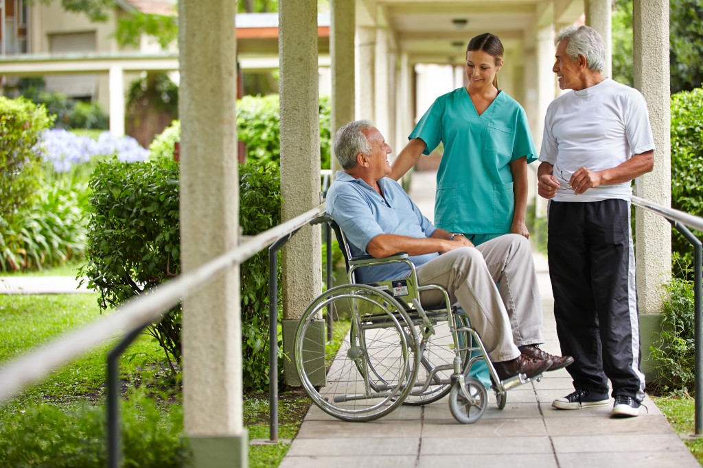 Senior citizens talking to a nurse