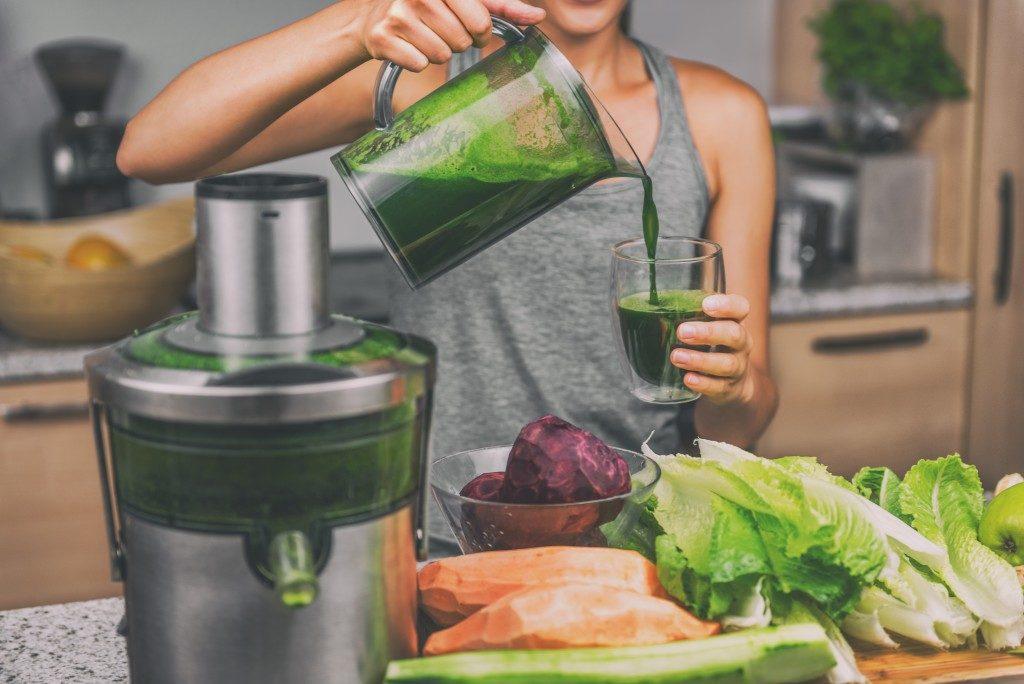 girl making vegetable shake