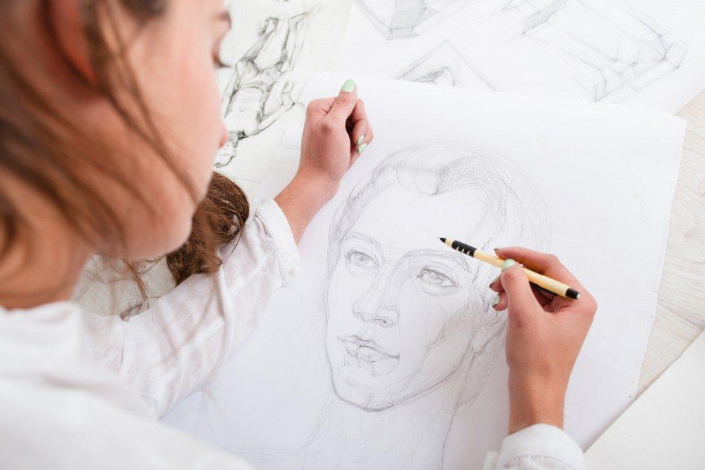 Artist drawing a man using a pencil