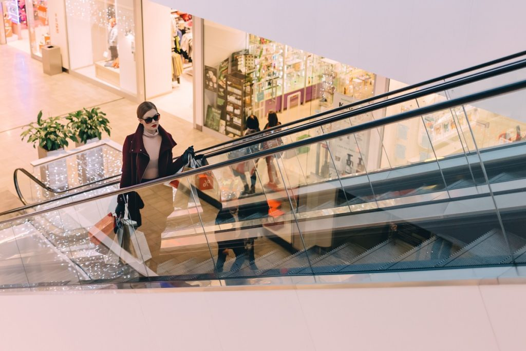 Woman in a shopping mall riding the elevator