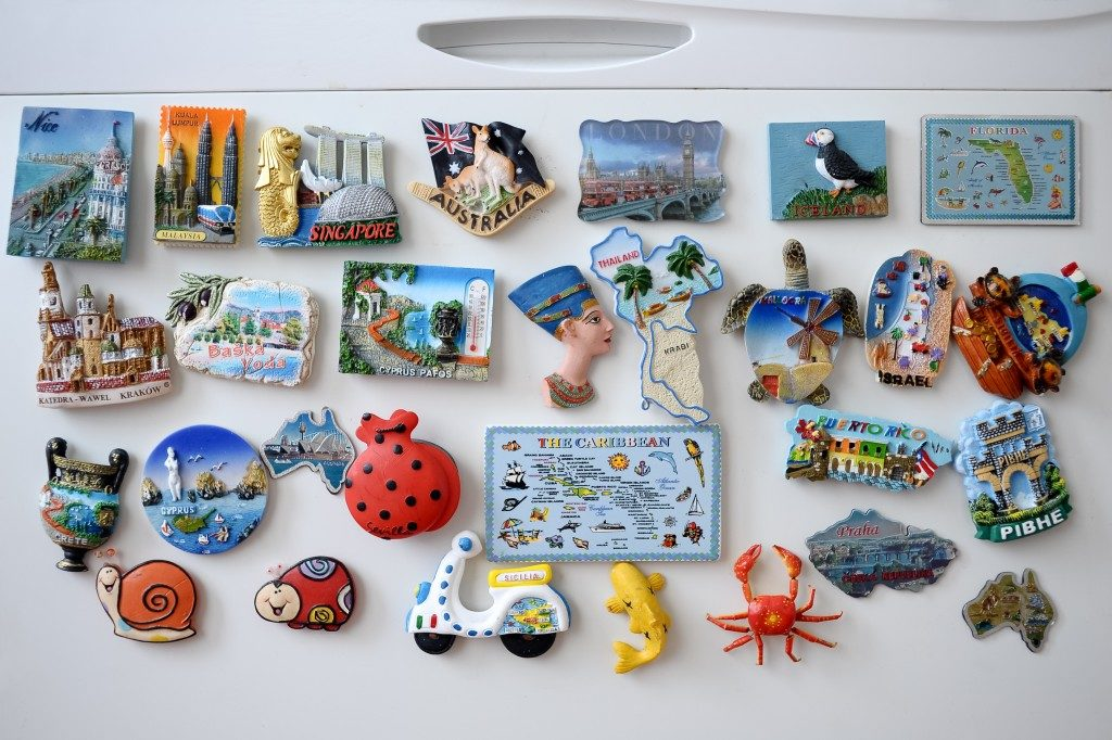 souvenir magnets on fridge