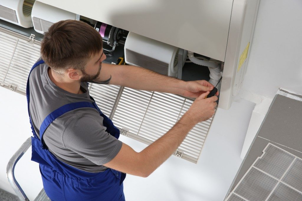 contractor fixing ventilation