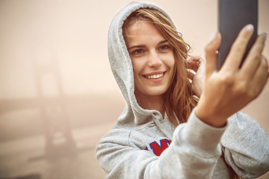 Woman smiling and taking a selfie