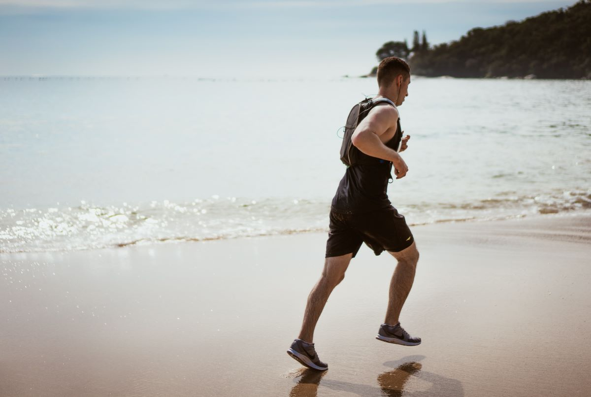 man jogging on the beach